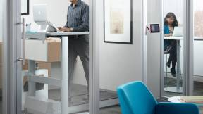 Man working on a Walkstation in a private office
