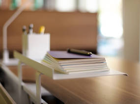 Close-Up of Bivi Top Shelf with notebooks and pens