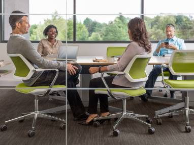 People sitting on QiVi Collaborative Chairs in a conference room