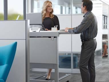 Woman on Walkstation talking to co-worker