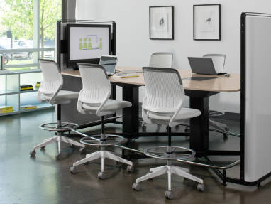 Cobi office chairs around a media:scape