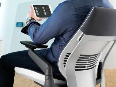 man viewing tablet in Gesture office chair
