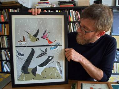 Charlier Harper, Designtex displaying a framed drawing of a squirrel and birds