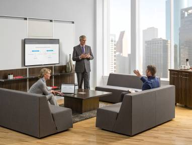 FlexFrame Workwall in convene conference room with three people conversing