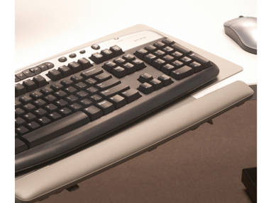 Close-Up of keyboard on a Grey Keyboard Platform with a mouse nearby