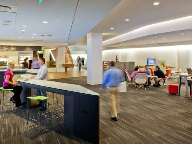 A WorkCafe at Steelcase headquarters featuring SW_1 lounge seating and Last Minute stools from Coalesse