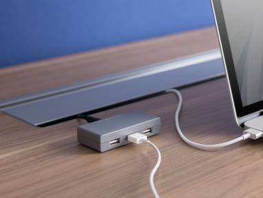 SOTO USB Charging Station next to a laptop