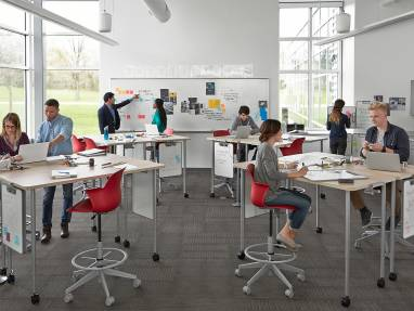 Verb Tables and Whiteboards and Blue Node Chairs in an active learning classroom setting