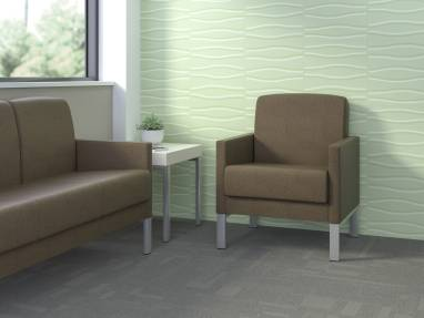 Brown Leela three-seat lounge seat and lounge armchair in a medical office waiting room