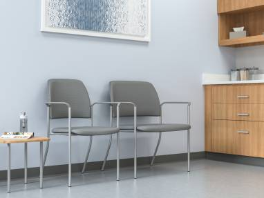Two Grey Sorrel Stacking Chairs with Arms in medical exam room