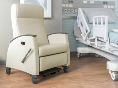 Cream Mitra Recliner next to a hospital bed