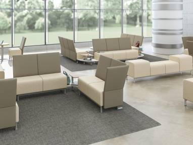 Neighbor lounge seating and benches in a large waiting room