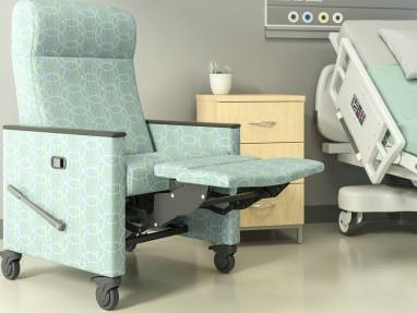 Green Mineral Recliner with footrest extended in front of a hospital bed