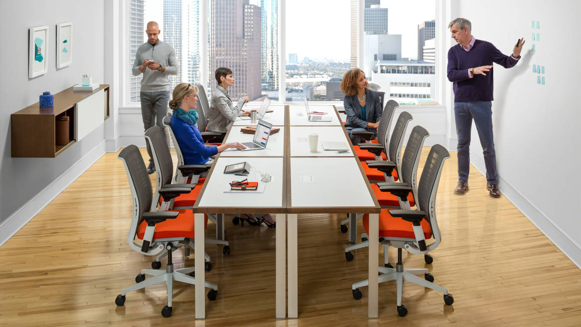 people at a meeting sitting in Think office chair