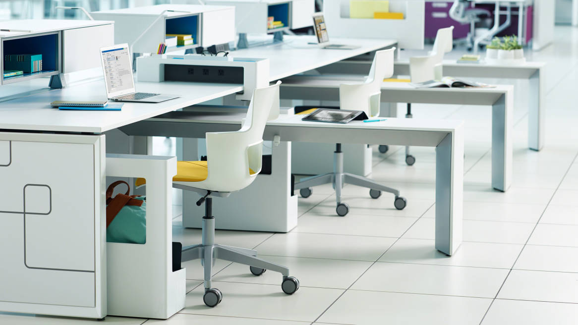 Three workstations in a row divided by White Campfire Slim Tables with Shortcut Task Chairs