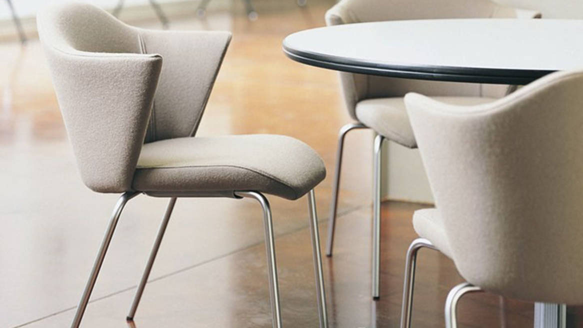 Three Capa Stackable Chairs around a round table