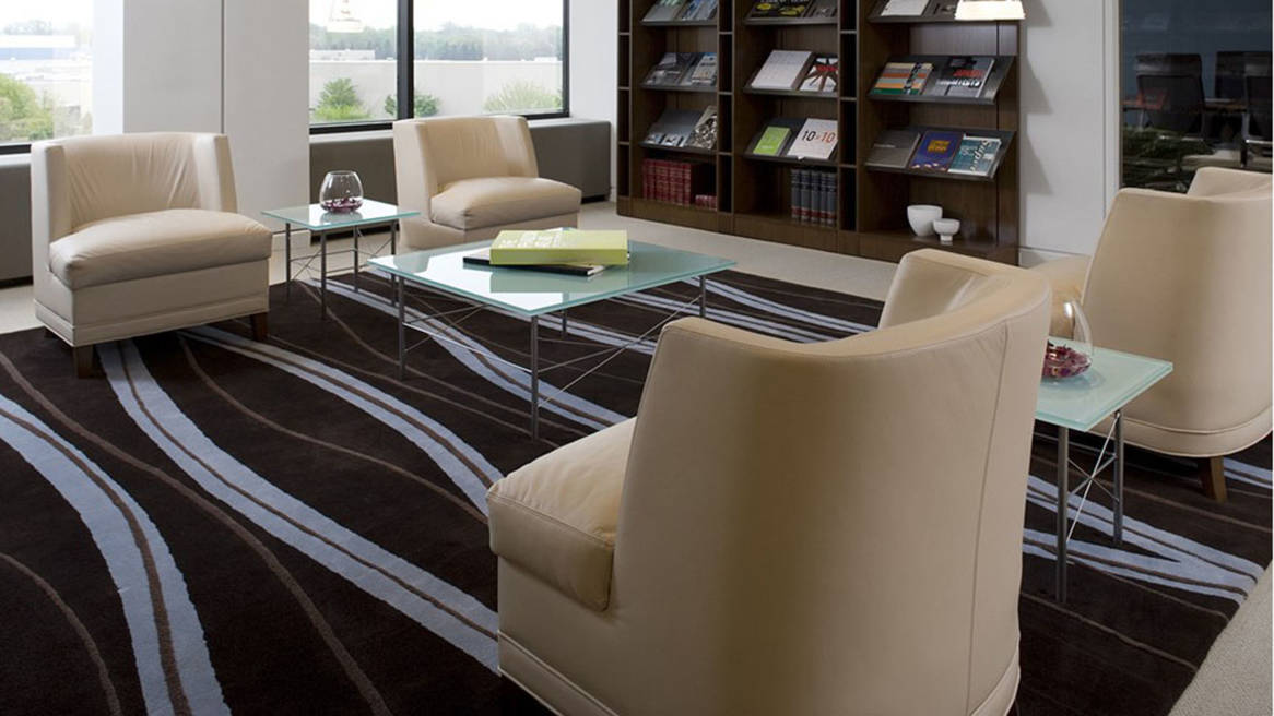 Four Thoughtful Lounge Chairs next to bookshelves