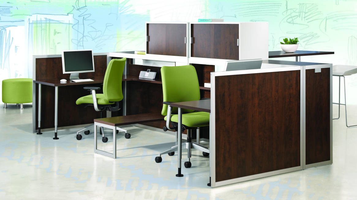 Two Tour Workspaces with dark wood veneer and green chairs