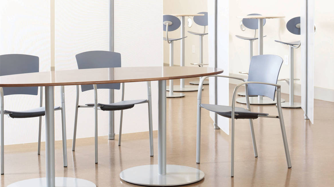 Three Enea Stacking Chairs at a table