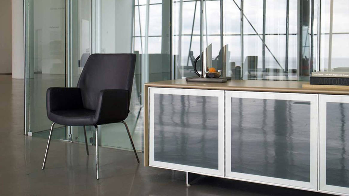 Host Credenza next to a chair