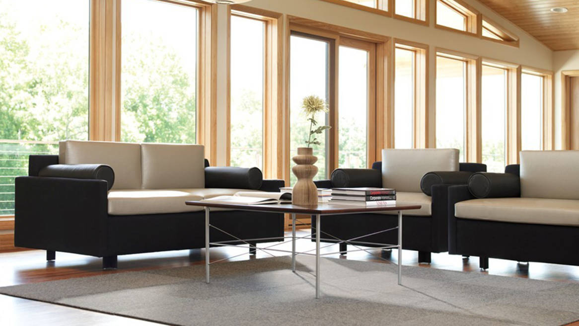 Evaneau lounge seating from Steelcase is arranged around a square table in an office lounge setting
