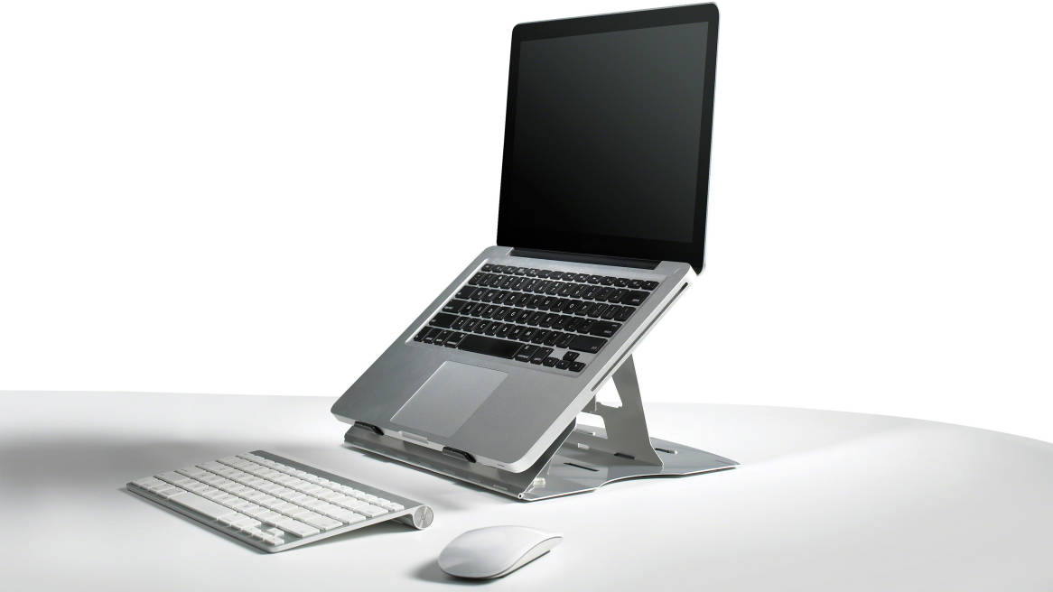 Mobile Laptop Support with a laptop opened on a desk with a keyboard