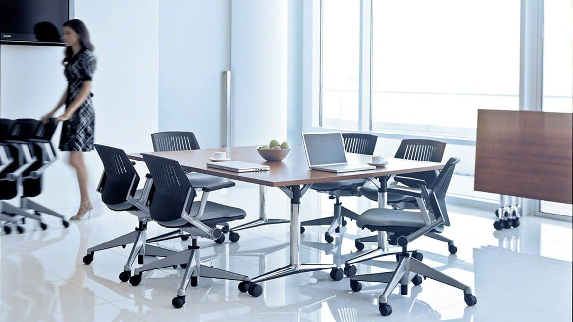 Six Black Kart Nesting Chairs around a conference table