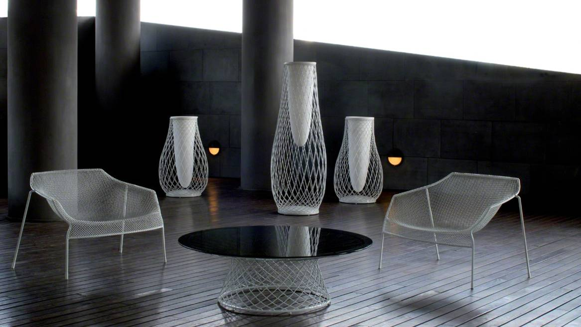Three White Emu Heaven Vases in a lounge area