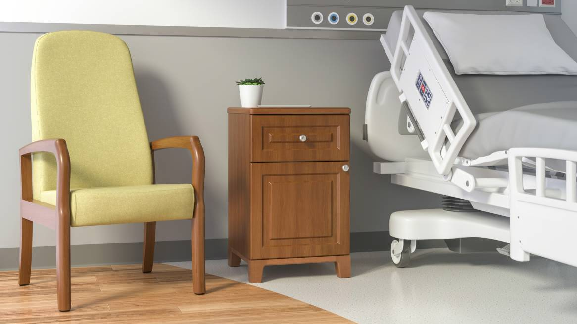 Waldorf Bedside Table with drawer and cabinet in between an armchair and hospital bed