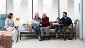 A family uses a Surround lounge system from Steelcase in a healthcare setting