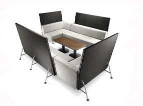 Black and white Bix Lounge System with a dark wood finish coffee table in the middle