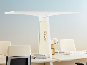 A white Bivi Canopy divides two Bivi Tables for Two. Steelcase Gesture desk chairs with white upholstery are also seen.