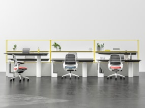 Mackinac benching system used to create a workstation for six people Steelcase Series 1 chairs are at each desk