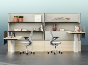 Two Steelcase Mackinac desks next to each other with Gesture chairs at each desk