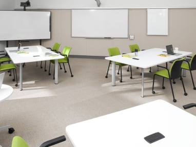 Reply chair with wheels in classroom setting
