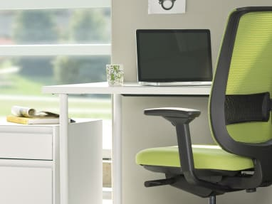Reply office chair facing desk