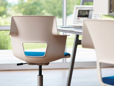 Rear-view of Shortcut chair at a workstation