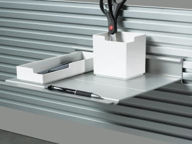 Slat wall holding a SOTO tool and utililty box