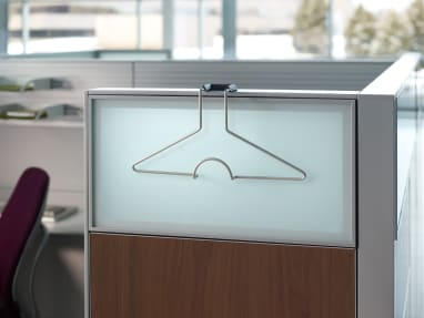 Champagne Flat Top Hanger resting over a privacy screen of a workspace