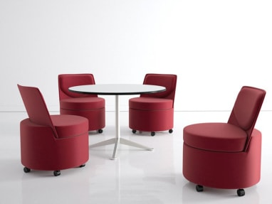 Four Red Topo Lounge Chairs with Casters around a white round table