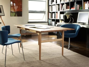 Dining Table CH327 in an office with three blue chairs around it
