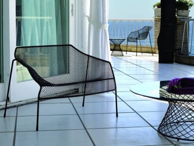 Two sets of Black Emu Heaven Chairs and Tables on a balcony