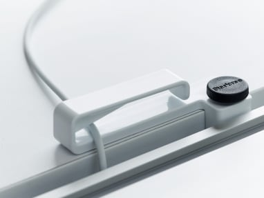 SOTO Cable Clip on a desk with a wire running through