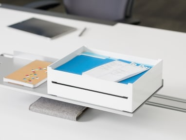White and Blue SOTO Pile Box on a workstation surface
