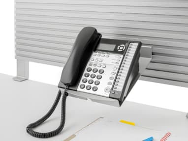 Telephone Caddy supporting a landline phone
