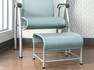 Close-up of a Cura ottoman in front of a Cura Patient Chair