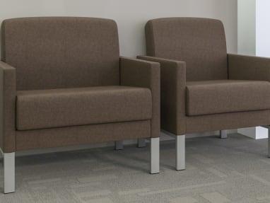 Brown Leela bariatric lounge arm chair and a Leela one-seat armchair