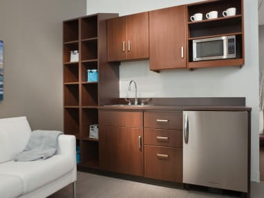 Dark wood finish Folio cabinets and countertop in a lounge