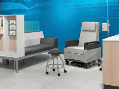 Light Grey Empath Patient Recliner and Verge Stool on casters