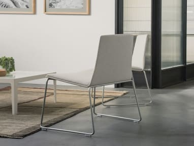 Montara650 Lounge Armless Chairs by a coffee table
